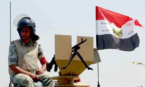 Emergency rule in Egypt's Sinai after bomb kills 30 troops