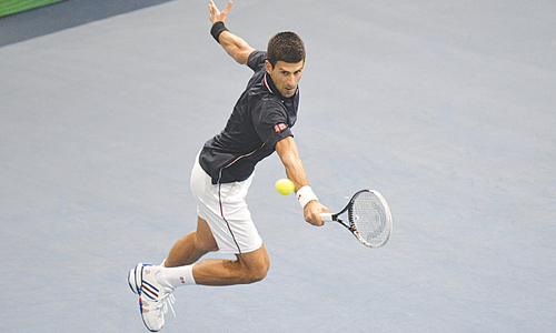 Djokovic breezes through in Paris