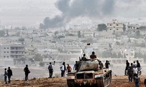 Kurdish fighters start entering Syrian border town