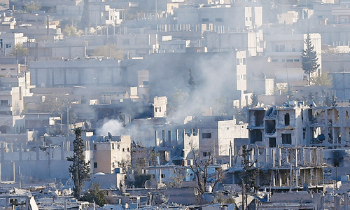 Kurds seize IS arms, buildings in besieged town