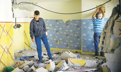 In razing homes, Israel revives tough punishment