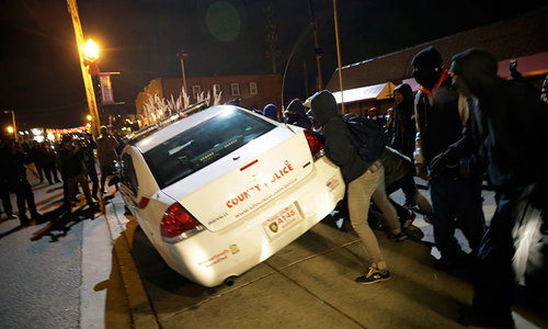 Ferguson protests flare into violence after no indictment in Brown death