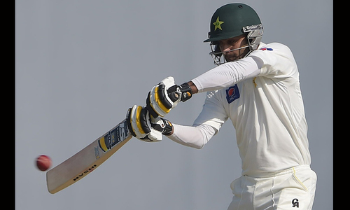 Pakistan steady after Masood's fall