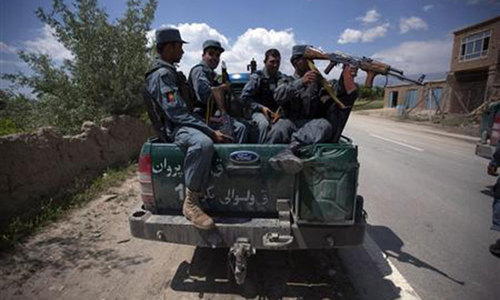 As casualties soar, Afghan police taught how to stay alive