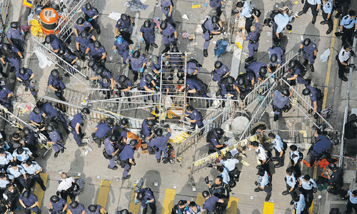 Police clear Hong Kong camp of protesters, arrest leaders