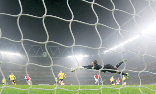 Atletico, Arsenal reach knockout phase
