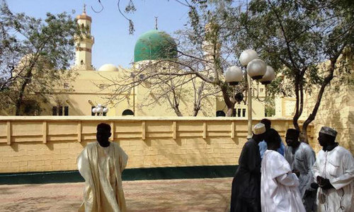 Suicide bombers, gunmen kill 64 at prominent Nigeria mosque