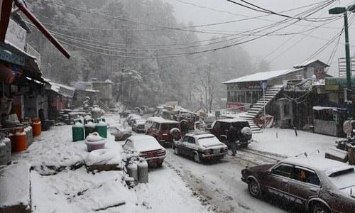 Heavy snowfall blocks roads, disrupts power supply in KP