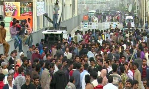 Demonstrators gather during protest - DawnNews screen grab