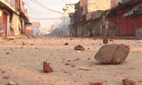 Bricks thrown by demonstrators during protest - DawnNews screen grab