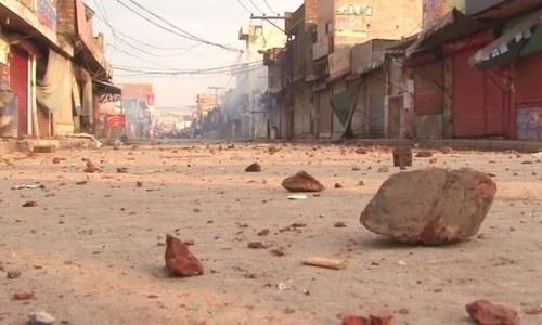Bricks thrown by demonstrators during protest - DawnNews screen grab