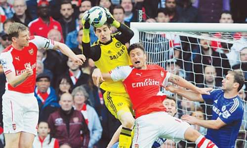 Chelsea hold Arsenal to edge closer to title