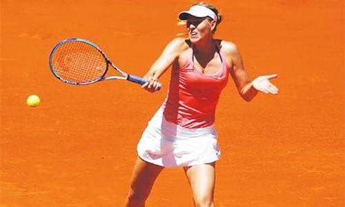 Sharapova advances in Madrid