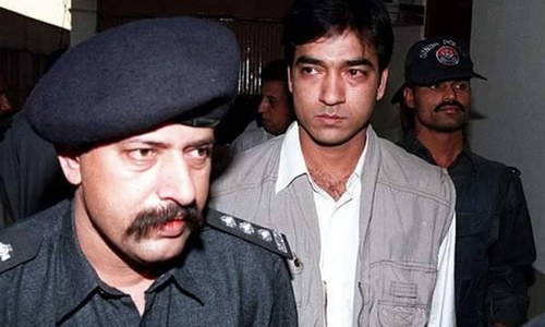 This 1998 picture shows Saulat Mirza alongside then SHO Choudhry Aslam.─ Nazir Shah