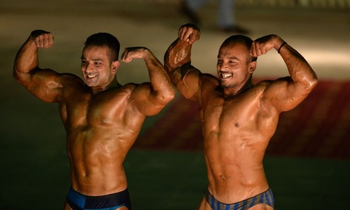 Bodybuilders flex muscles for Mr Islamabad title