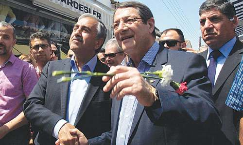 Rival leaders take stroll through divided capital of Cyprus