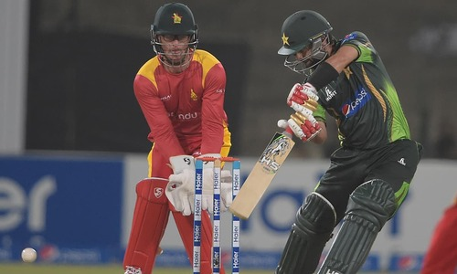 Umar Akmal drives Pakistan after middle order collapse