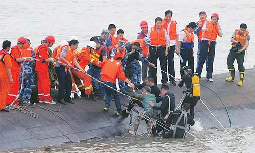 Over 400 go missing as Chinese cruise vessel capsizes