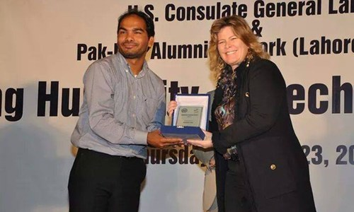 Sabir is pictured receiving an award in Lahore by the US Council.