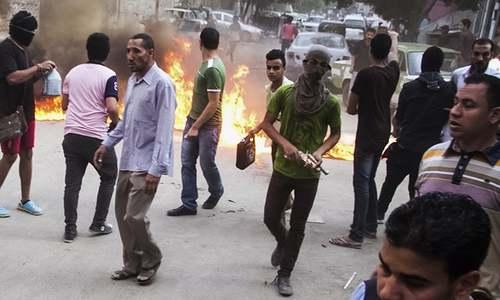 Militants attack Egyptian army checkpoints in Sinai, kill 30