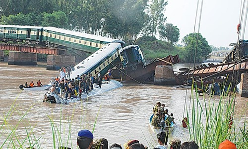 17 die as train carrying troops plunges into canal