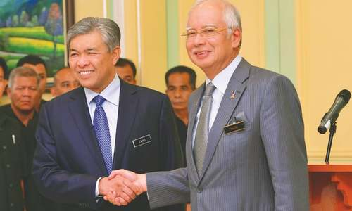 Malaysian PM replaces deputy, sacks AG amid scandal