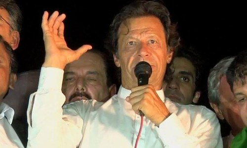 Imran Khan addressing supporters in Lahore after a tribunal ordered re-polling in NA-122. – DawnNews screengrab