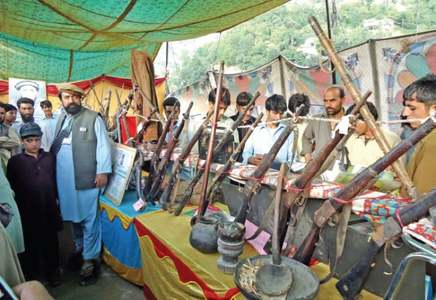 Old guns, swords attract visitors at exhibition
