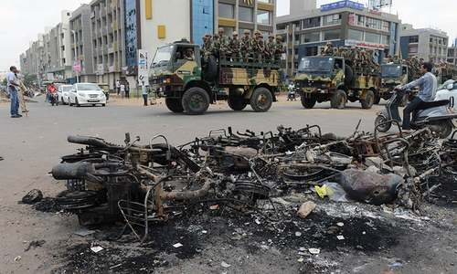 Indian troops patrol Gujarat after deadly communal riots kill 10