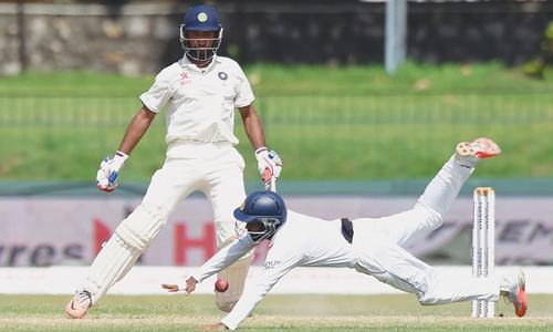 Pujara's comeback century leads India recovery