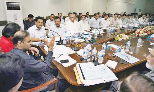Abid asks Hesco not to spare depts in drive against defaulters