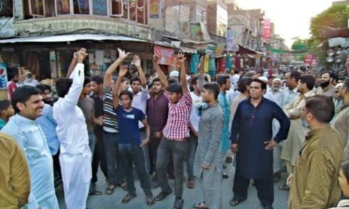 Traders hold rallies against withholding tax
