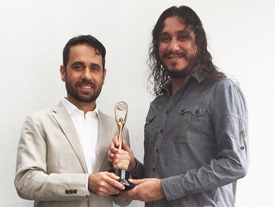 (L) Ali Rez, Creative Director and (R) Assam Khalid, Strategic Planning Director, with the award.