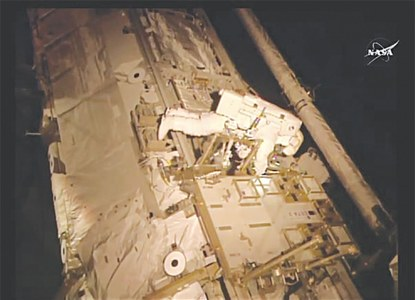 US astronauts on risky spacewalk to fix cooling system