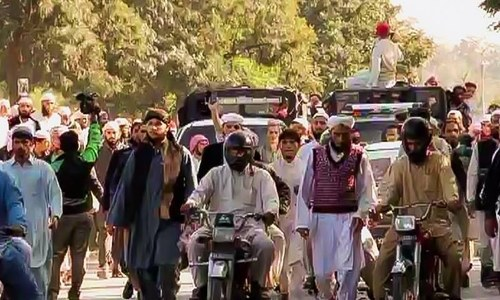 The rally, led by Aziz and Umme Hassan comprises students of the seminary and is currently under way.— DawnNews screengrab