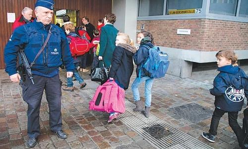 Schools, metro reopen in Brussels despite terror alert
