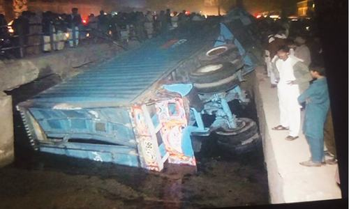 Man killed, 10 injured as train derails after hitting trailer