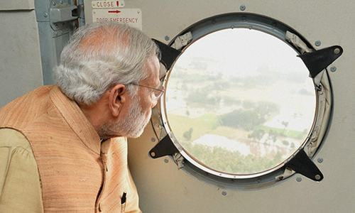 India deletes doctored photo of Modi at flood scene, aides promise action