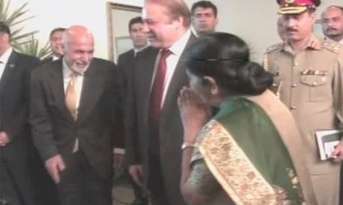 Indian Foreign Minister Sushma Swaraj and Afghan President Ashraf Ghani greet each other. ─ DawnNews screengrab