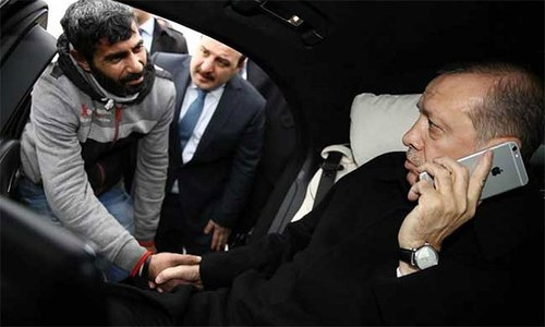 Turkey's Erdogan talks man on bridge out of suicide