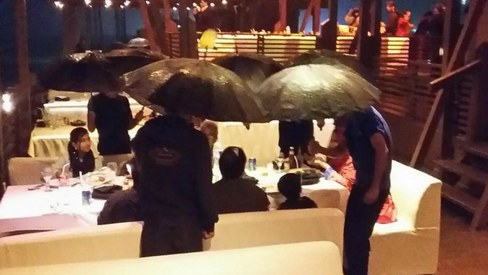 This photo of waiters holding up umbrellas has sparked a debate on food groups