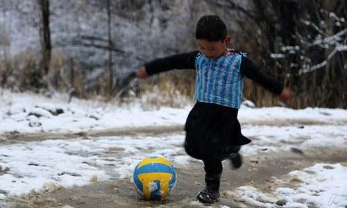Afghan boy becomes Internet star after plastic shirt goes viral