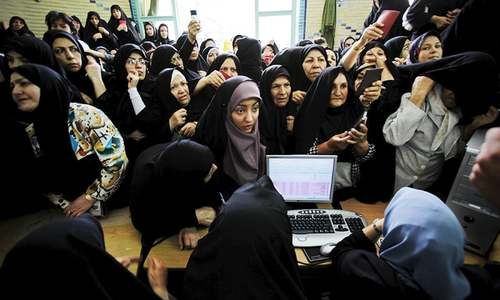 Why vote? Iran's women and youth disillusioned in run-up to parliamentary polls