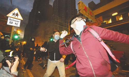 90 police personnel hurt in clash with hawkers in HK