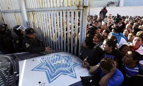 Drug cartel battle kills 52 in Mexican prison