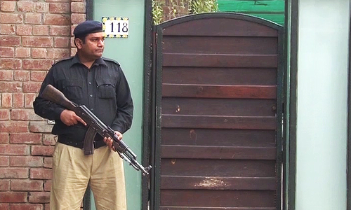 Security at the Taseer residence.—DawnNews