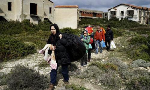 Turkey, Greece scramble to start EU deal as migrant arrivals rise