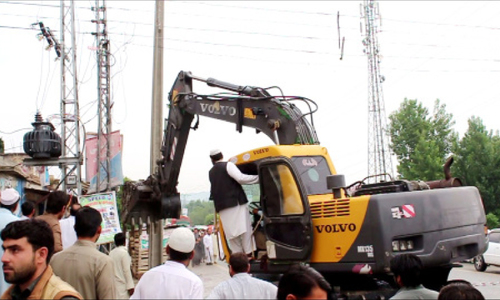 Over 20 booked for bringing down power pylons in Dir