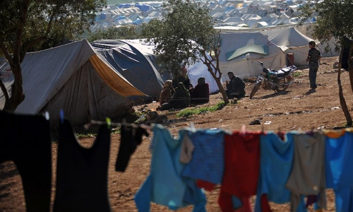 At least 28 dead in air raids on Syria displaced camp near Turkey