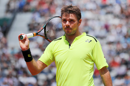 Wawrinka makes smoother progress past Japan's Daniel